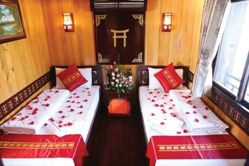 Phòng ngủ Twin du thuyền Dugong cruise.jpg